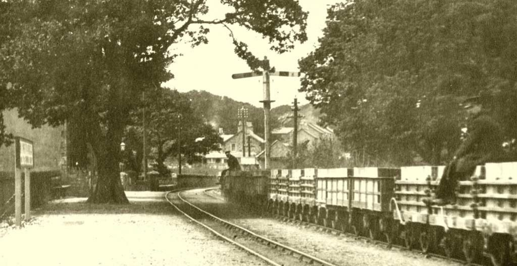 Minffordd in old company days, complete with passing gravity train.